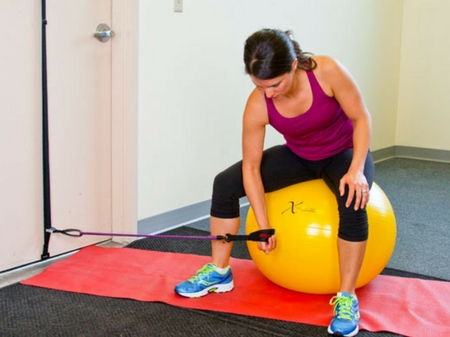 woman on an exercise ball